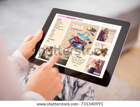 Woman shopping for clothes online. #731340991