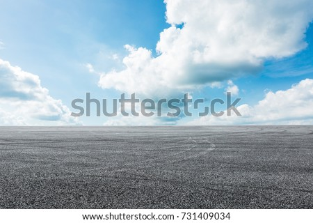 Asphalt road circuit and sky clouds with car tire brake #731409034