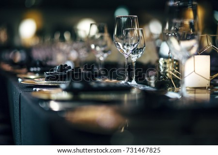 Luxury table settings for fine dining with and glassware, beautiful blurred  background. Preparation for holiday  Christmas and Hannukah dinner night. #731467825