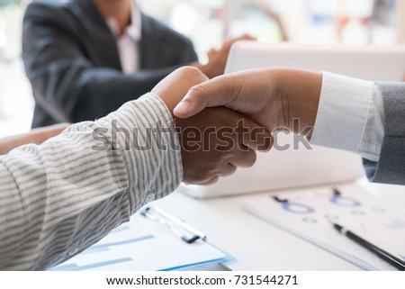 Business people shaking hands after finishing up a meeting. Businessman handshaking after conference. Greeting deal, teamwork, partnership, collaboration, corporate concept. #731544271