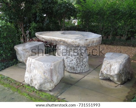 One table and 3 chairs which is made by stone in ancient time. #731551993