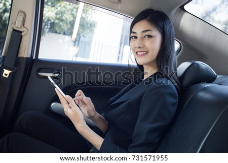 Woman using Smartphone for working in car, Woman working concept. #731571955