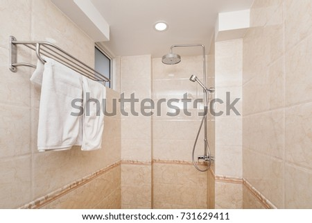 Shower room with tiled walls, nobody #731629411