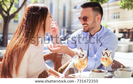 Romantic couple drinking coffee and enjoying in fruit desserts, having fun in the cafe. Dating, love, relationships #731672350
