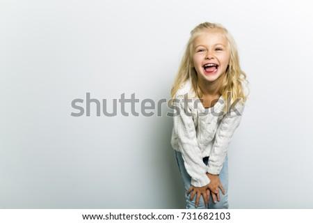 Cute girl 4-5 year old posing in studio #731682103