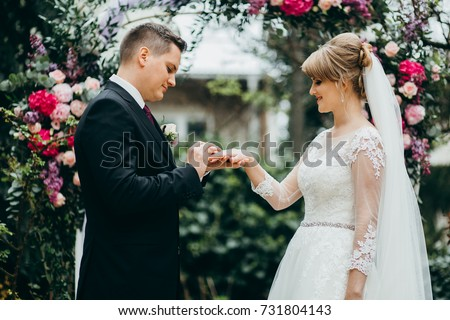 Bride and groom are getting married on the wedding ceremony  #731804143