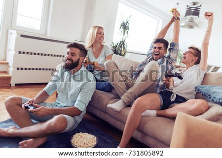 Friends having fun on the couch with video games. #731805892