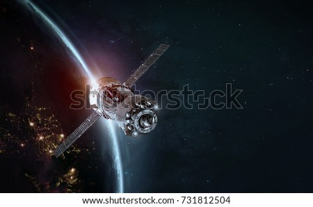 Space station and space ship in the outer space. Earth sunshine on the background. Elements of this image furnished by NASA Royalty-Free Stock Photo #731812504