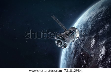 Spaceship in the space and earth in the night on the background. Communication between cities. Elements of this image furnished by NASA Royalty-Free Stock Photo #731812984