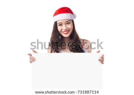 Asian Christmas girl with Santa Claus clothes holding blank sign isolated on white background #731887114