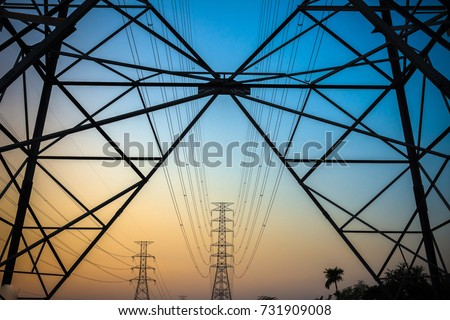 Green energy concept, Electricity station, Close up high voltage power lines at sunset. electricity distribution station. high voltage electric transmission pylon silhouetted  tower. #731909008