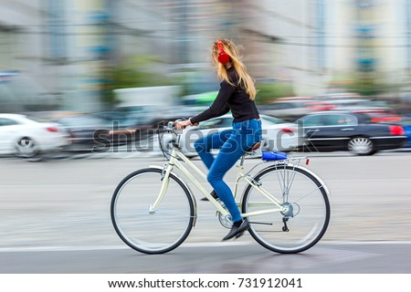 active people on bicycle  in the city roadway  in motion blur #731912041