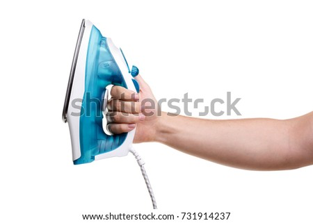 Hand of a man holding an iron on a white background isolated