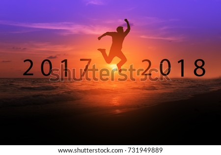 Silhouette of men jumping above the sea from year 2017 to year 2018, new year, business successful concept. #731949889