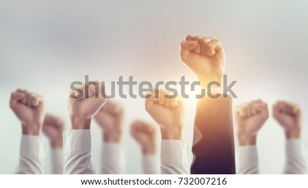 Hands of Business team raised fist air Corporate Celebration victory, success and winning concept. sunlight effect. Royalty-Free Stock Photo #732007216