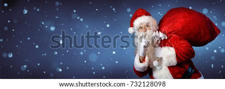 Santa Claus Carrying Bag In Night #732128098