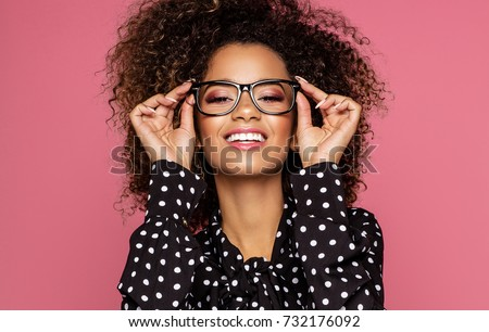 Portrait of the beautiful smiling black woman wear glasses  #732176092