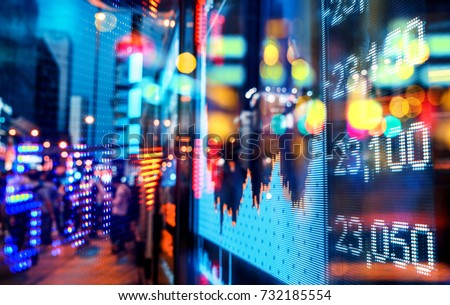 Display of Stock market quotes with city scene reflect on glass #732185554