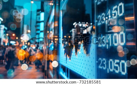 Display of Stock market quotes with city scene reflect on glass Royalty-Free Stock Photo #732185581