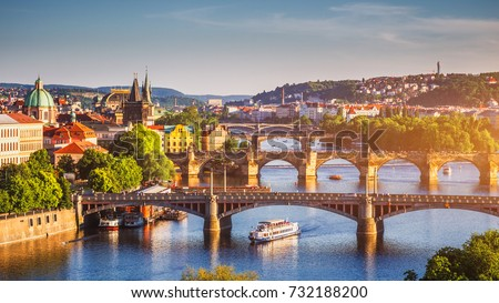 Scenic spring sunset aerial view of the Old Town pier architecture and Charles Bridge over Vltava river in Prague, Czech Republic Royalty-Free Stock Photo #732188200