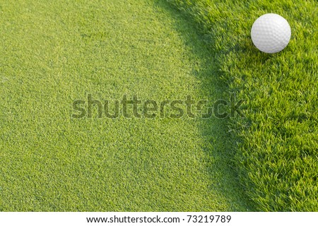 Golf ball on Green tee.Golf Sport is Balance of Yin Yang. Paste the text into the space right hand side. sport background