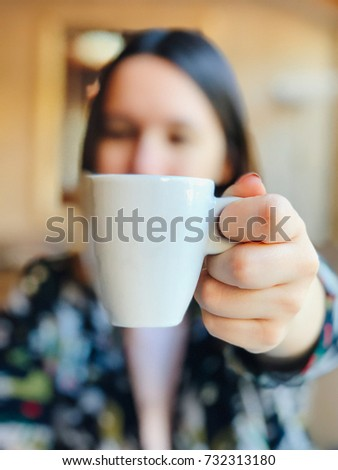 Young woman with a cup of coffee Royalty-Free Stock Photo #732313180