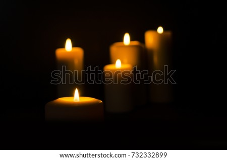 Fire candle on dark black background