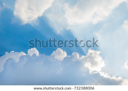 Sun rays through clouds with blue sky #732388006