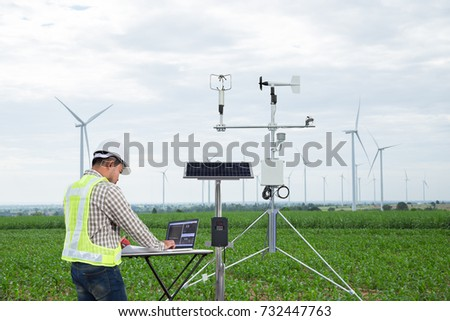 Engineer using tablet computer collect data with meteorological instrument to measure the wind speed, temperature and humidity and solar cell system on corn field, Smart agriculture technology concept Royalty-Free Stock Photo #732447763