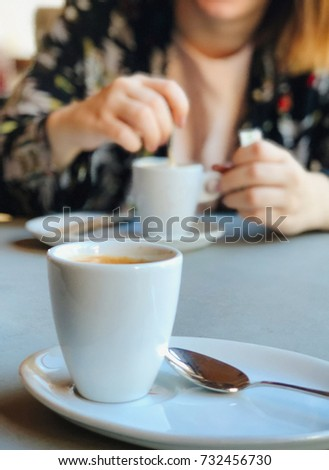 Young woman with a mug of coffee Royalty-Free Stock Photo #732456730