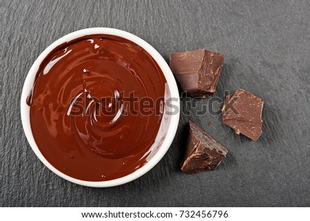 Melted chocolate and chocolate pieces. #732456796