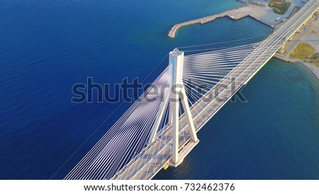Aerial bird's eye drone photo of state of the art suspension bridge crossing the sea #732462376