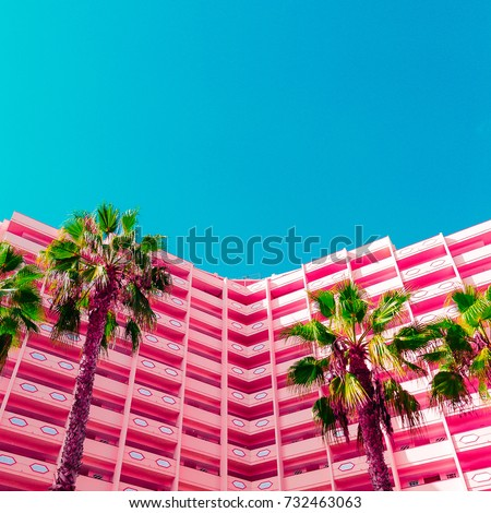 Palms and hotel.  Life in pink. Minimal. Stylish tropical urban