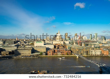 London skyline with a view of St Paul's Cathedral, Millennium Bridge and skyscrapers of the north bank of the River Thames on a sunny day