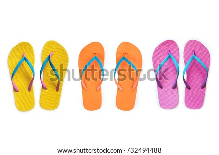 Yellow Orange Pink flip flops isolated on white background. Top view #732494488