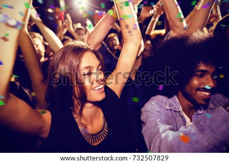 Flying colours against friends dancing at nightclub #732507829