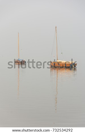 Emigration boat in a special light mood with fog on Lake Steinhude #732534292