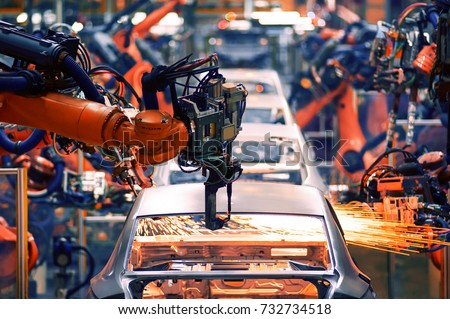 The arm of a car production line Royalty-Free Stock Photo #732734518