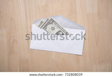 dollar money in the envelope on wood table. bonus, reward, benefits concept. #732808039
