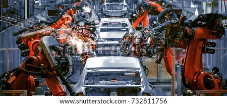 The welding arm on the automobile production line is being welded Royalty-Free Stock Photo #732811756