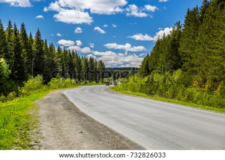 Road, natural landscape and Cumulus clouds. #732826033