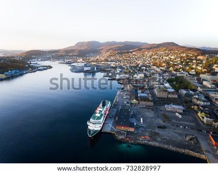 Aerial view of Norwegian Hurtigruten cruiseship in the small harbour of Harstad.