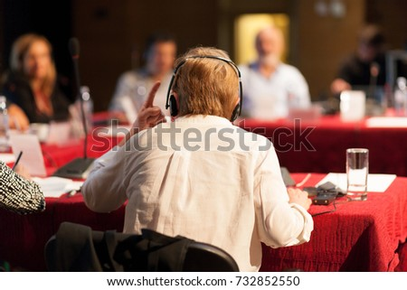 heated debate at a conference discussion Royalty-Free Stock Photo #732852550