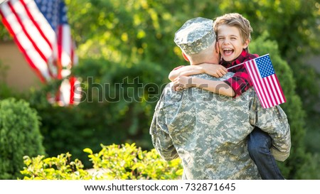 Happy reunion of soldier with family, son hug father #732871645