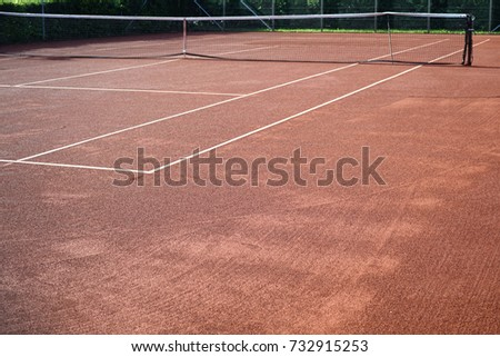 Red clay Tennis court on a sunny day #732915253