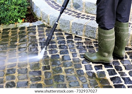 An Image of walkway cleaning - high pressure cleaner Royalty-Free Stock Photo #732937027