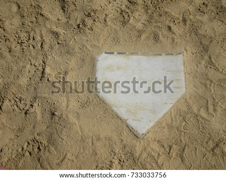Home plate on the right with copy space on left with sand background #733033756