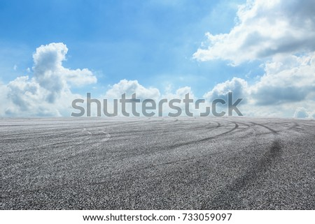 Asphalt road circuit and sky clouds with car tire brake #733059097