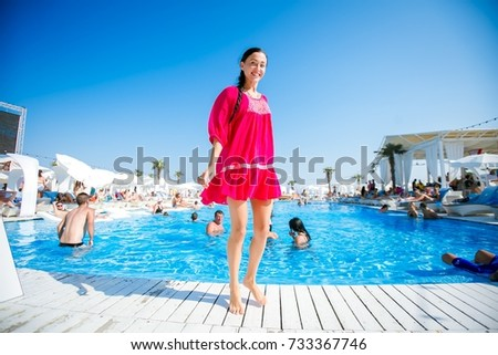 Odessa, Ukraine August 29, 2015: Women relaxing in luxury beach resorts during summer holidays. Girl rest on day lounge party at elite beach resorts of Ibiza. #733367746
