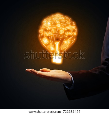 Close of businessman showing sketched idea in palm #733381429